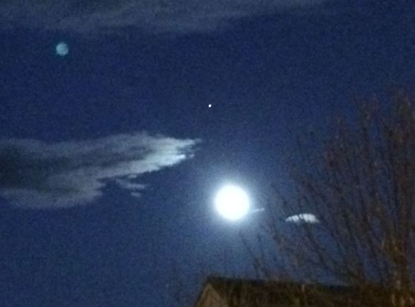 The Full Moon and Mars in view of my house with the Space Station just having passed by Mars
